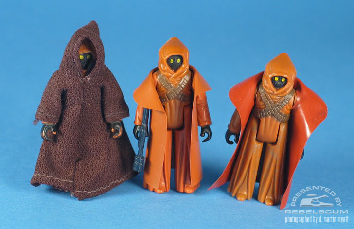 Left To Right: Domestically Released Fabric Robe Jawa, Domestically Released Vinyl Cape Jawa, Australian Released Toltoys Vinyl Cape Jawa