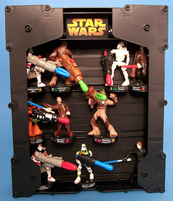 Bases of figures slide into slots on case