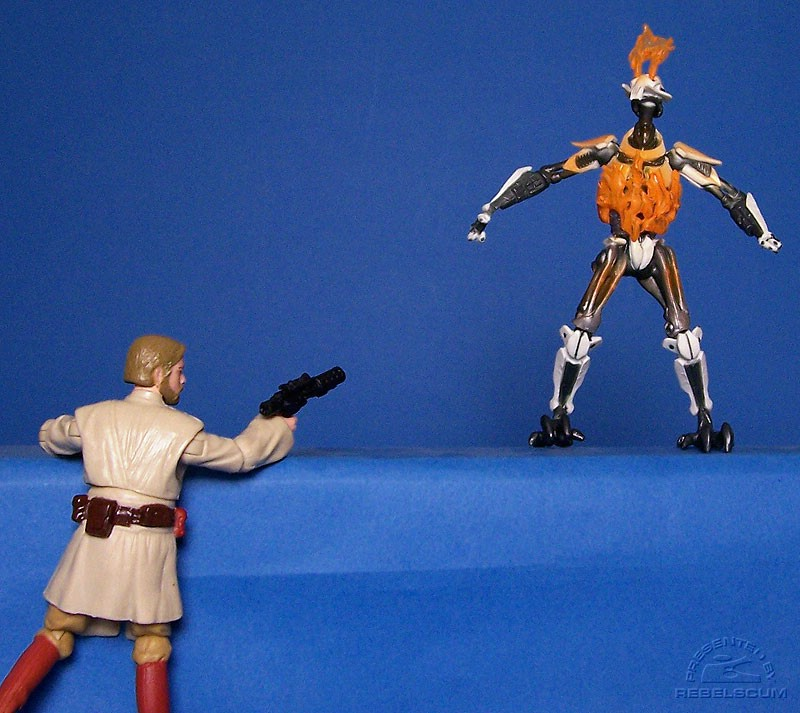 Obi-Wan blasts Grievous with his own blaster!