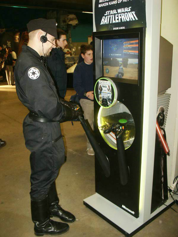 Imperial Officer enjoying some Battlefront (X-Box)