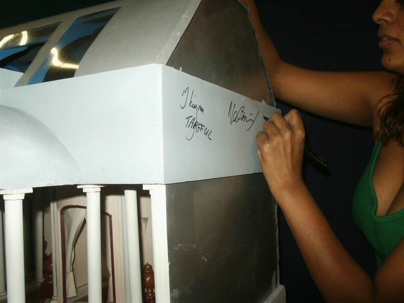 Nalini signing the dioramas