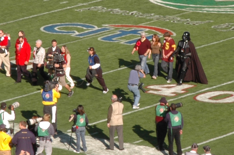 George walks onto the Rose Bowl field to toss the coin