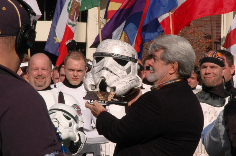 George is presented with a signed Stormtrooper helmet