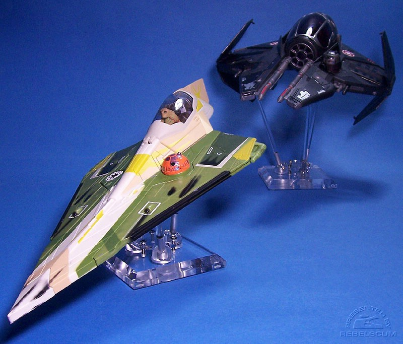 Darth Vader's Sith Starfighter (on a 6'' stand) pursues Kit Fisto's Jedi Starfighter (on a 2.5'' stand)